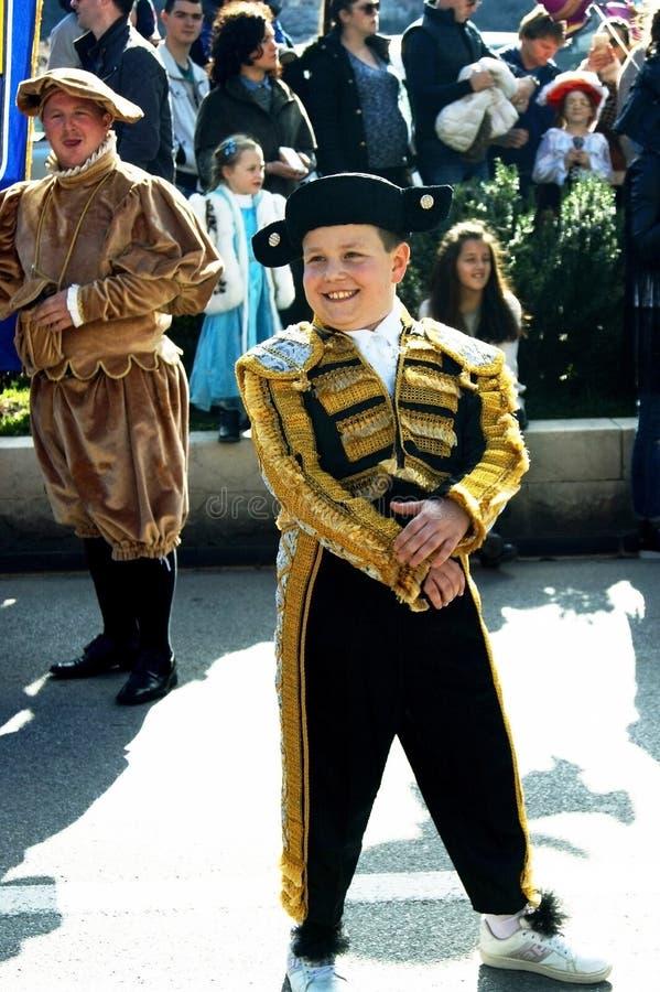 Montenegro, Kotor - 03/13/2016: Boy-bearer in fancy dress. stock images