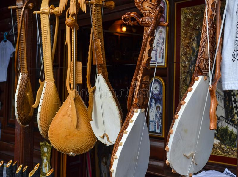 Montenegro. September 18, 2017. Shop with folk musical instruments - gusle. Stringed stringed instrument with the image of the ani stock photos
