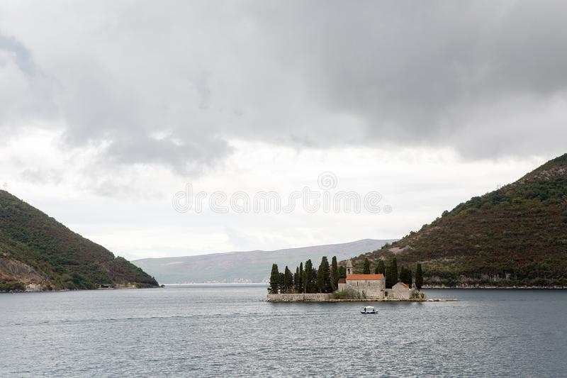 Montenegro St. George`s Island boat with tourists floating on the Bay royalty free stock photos