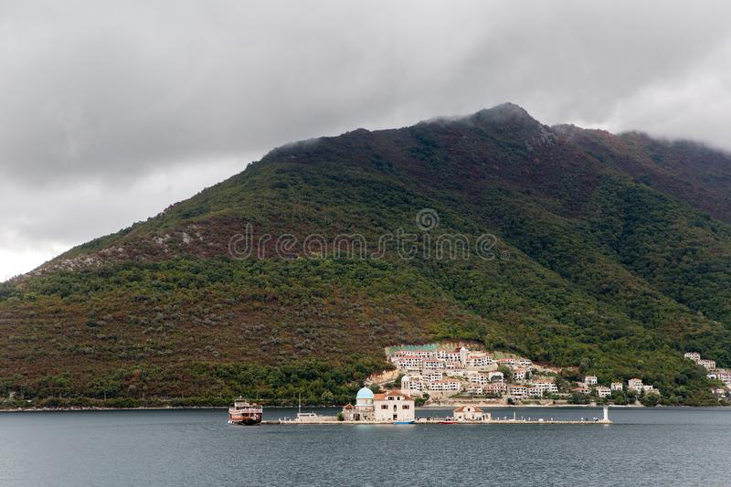 Montenegro St. George`s Island boat with tourists floating on the Bay stock image