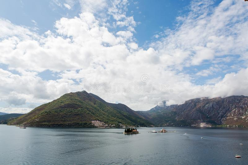 Montenegro St. George`s Island boat with tourists floating on the Bay royalty free stock photo