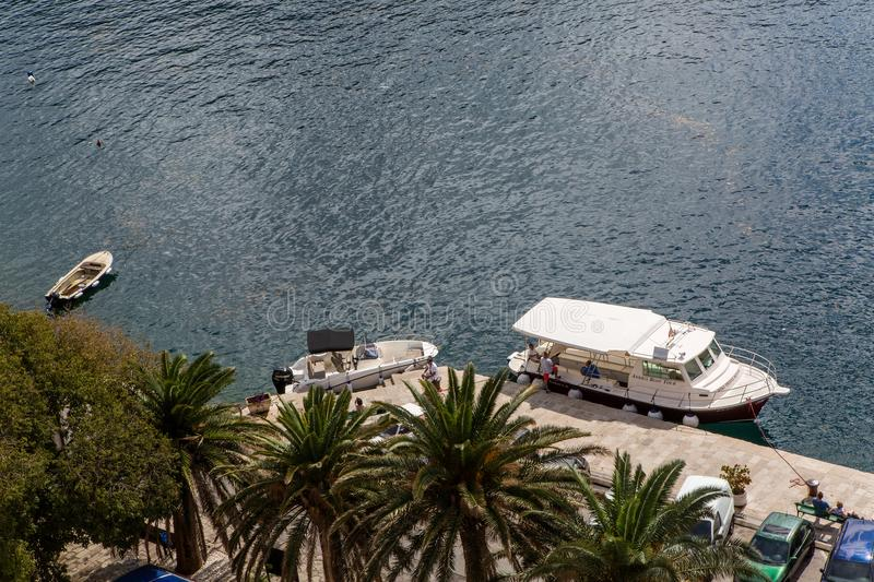 Montenegro St. George`s Island boat with tourists floating on the Bay stock photos