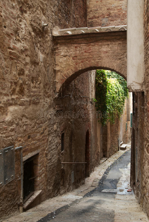 Montepulciano Alley. A narrow alley in the town of Montepulciano, Italy royalty free stock image