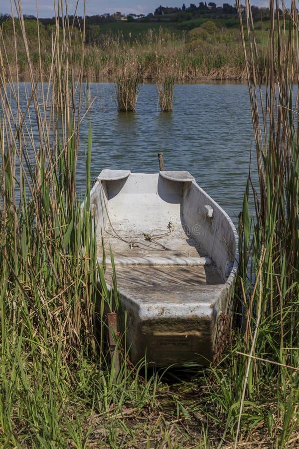 Fishing  boat at lago di Montepulciano. nature reserve. Tuscany. Italy. Montepulciano, Italy. 04-19-2019. Fishing  boat at lago di Montepulciano. nature reserve stock photos