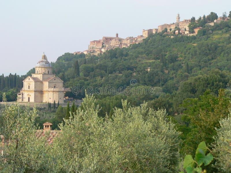 Montepulciano, Siena ( Italia ). Madonna di San Biagio church and Montepulciano on the hill stock photography