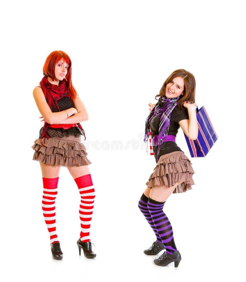 Monter meisje met het winkelen zakken en haar meisje stock afbeeldingen