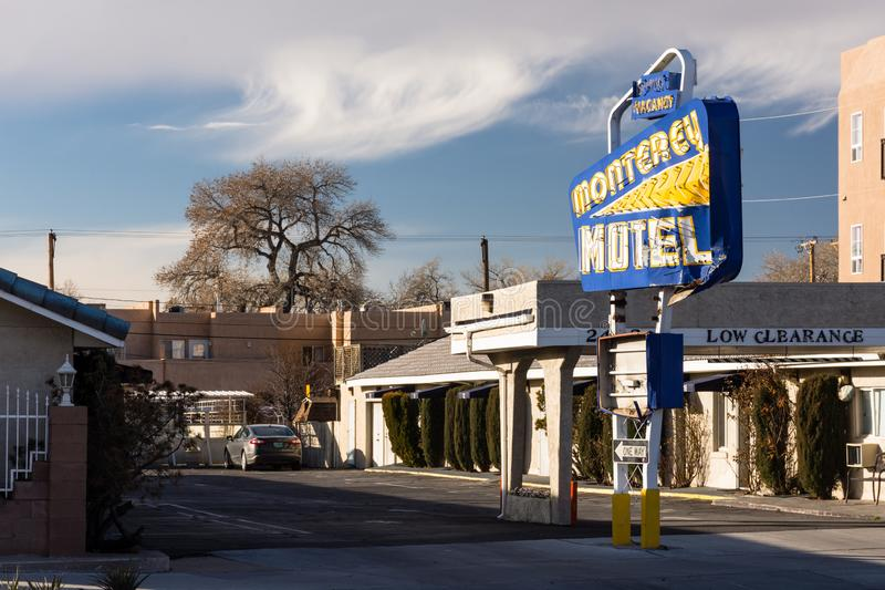 Colorful sign of the Monterey Motel on historic route 66. Albuquerque, New Mexico - February 1, 2019: Colorful blue and yellow sign of the Monterey Motel on royalty free stock images