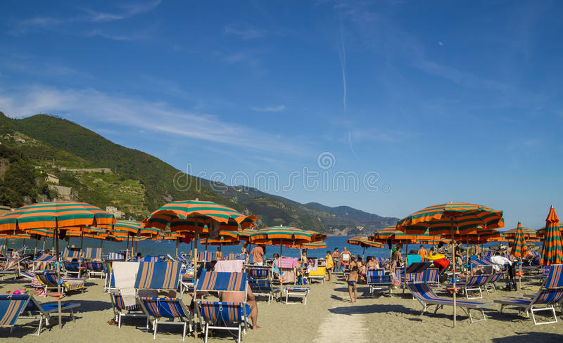 At the Monterosso Beach, Cinque Terre. MONTEROSSO,LIGURIA, ITALY - JUNE 26, 2015. Tourists at Monterosso Beach ,resort in the famous Cinque Terre, comune in the royalty free stock images