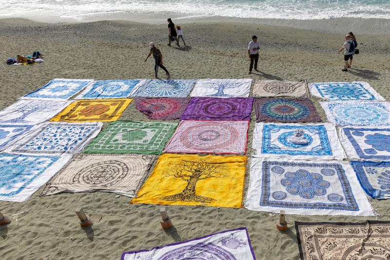 Beach blankets for sale at Monterosso Liguria Italy on April 22, 2019. Unidentified people stock photo
