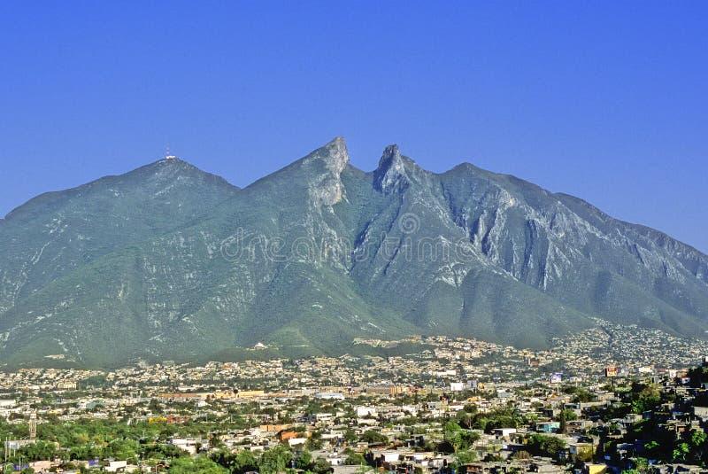 Monterrey city. In the background, the horse saddle mountain (cerro de la silla) symbol of this industrial city and capital of Nuevo Leon State stock photo