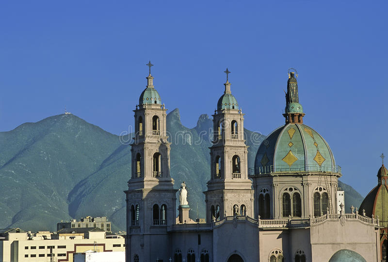 Monterrey City. Church of Our Lady of Perpetual Help, in the background the horse saddle mountain (cerro de la silla) at the city of Monterrey in Mexico royalty free stock image