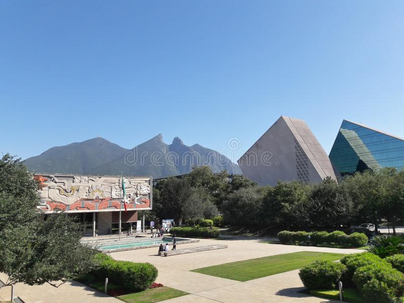 Monterrey Institute of Technology and Higher Education. Rectory of the Monterrey Institute of Technology and Higher Education with La Silla mountain in the stock photo