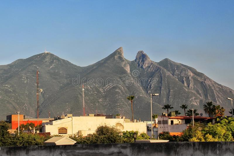 Monterrey, Mexico. 's third largest city with the Cerro de la Silla in the background stock image