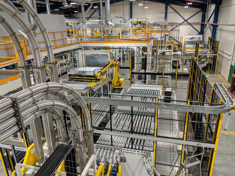 Robot in Can Manufacturing Plant stock image