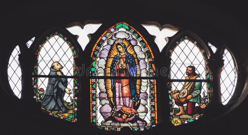 MONTERREY,NUEVO LEON / MEICO - 01 02 2017: Basilica de Guadalupe. Photograph of a stained glass window in Basilica de Guadalupe temple in Monterrey Nuevo Leon royalty free stock photos