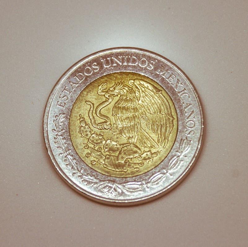 Five mexican pesos coin. MONTERREY, NUEVO LEON / MEXICO – FEBRUARY 20 2018: Close up photograph of five mexican pesos metal coin royalty free stock photos