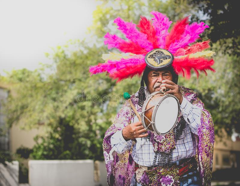 Mexican traditional musician performing on street. MONTERREY, NUEVO LEON / MEXICO - 11 12 2017: Mexican traditional indigenous musician man perfomrming on street royalty free stock photos