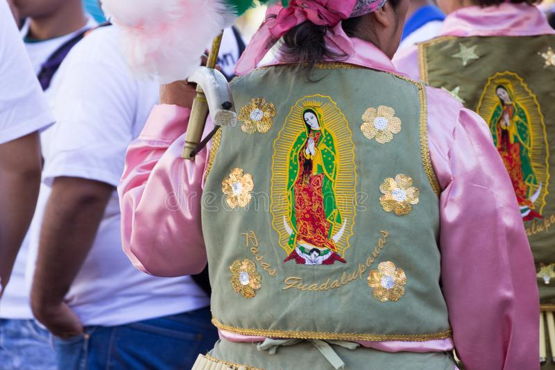 Traditional matachin mexican religious dancers. MONTERREY, NUEVO LEON / MEXICO - 18 12 2017: Mexican traditional matachin dancers in a peregrination to the stock photos