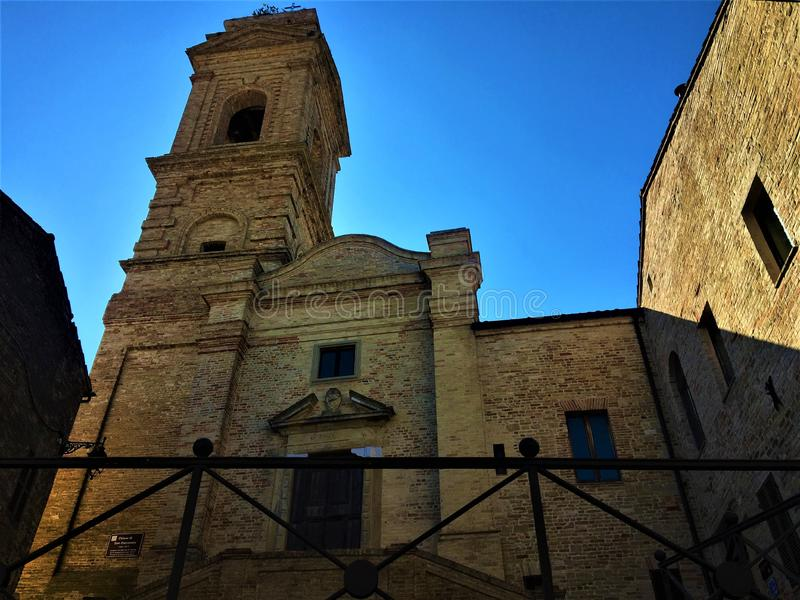Monterubbiano town, Fermo province, Marche region, Italy. History, time and shadows. Art and architecture, blue sky and light, tower and elevation, church and royalty free stock photos