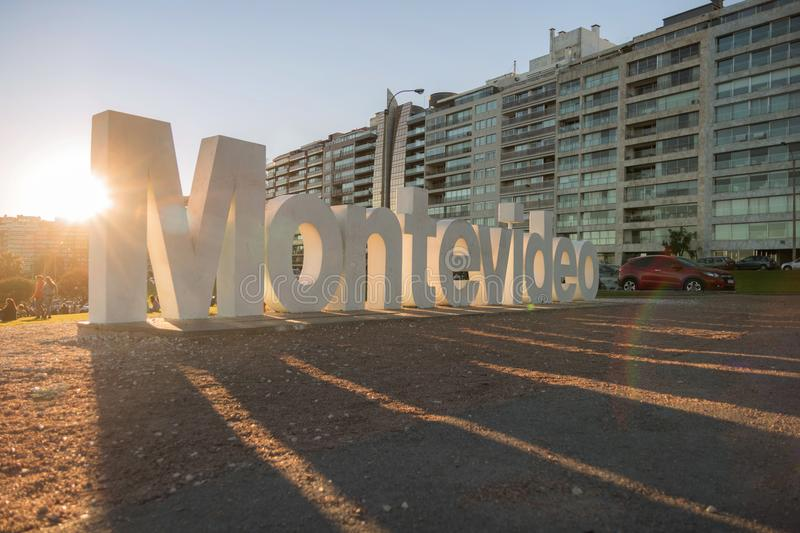 Montevideo sign in front of buildings stock images