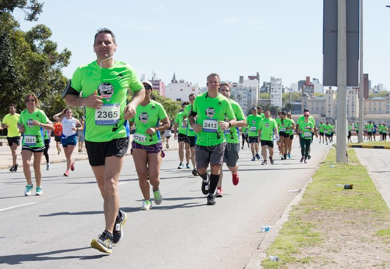 MONTEVIDEO, URUGUAY - SEPTEMBER 24, 2017: Runners in the middle of the race, Global Energy. stock photos
