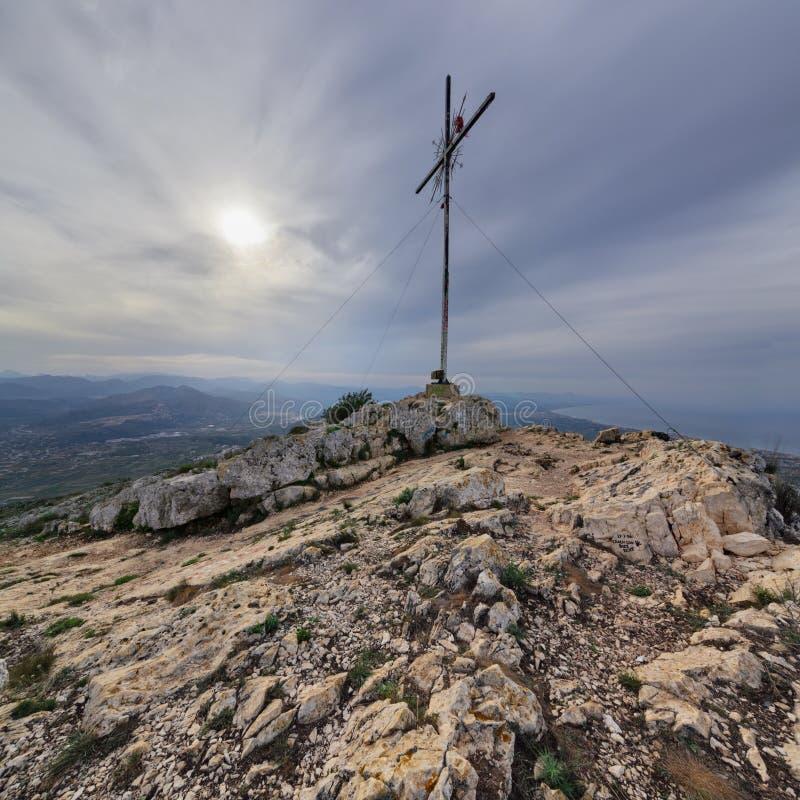 Montgo Peak. Cross on the top of the mountain Montgo, Denia, Spain royalty free stock images