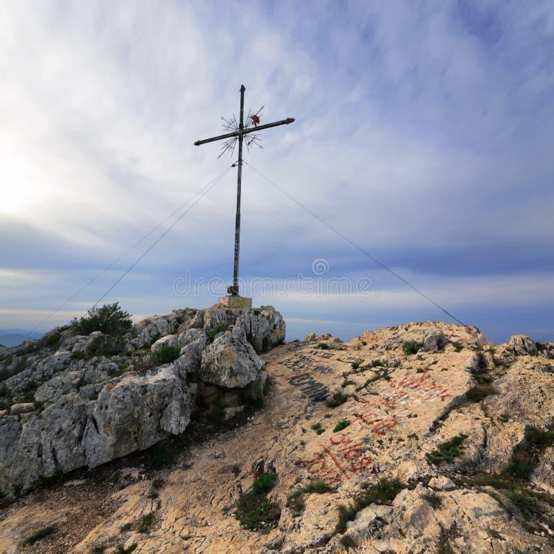 Montgo Peak. Denia. Cross on the top of the mountain Montgo, Denia, Spain stock image