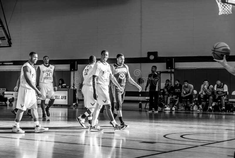 Maxwell Air Force Base Gunter Annex  Basketball Team Action Shots in Black and White. Montgomery, ALABAMA - JANUARY 26, 2019: Action shots of the Maxwell Air royalty free stock photos