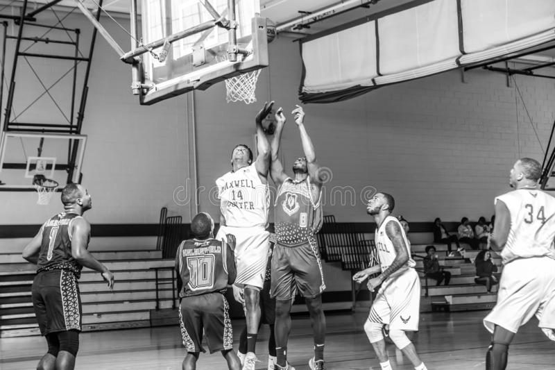 Maxwell Air Force Base Gunter Annex  Basketball Team Action Shots in Black and White. Montgomery, ALABAMA - JANUARY 26, 2019: Action shots of the Maxwell Air royalty free stock image