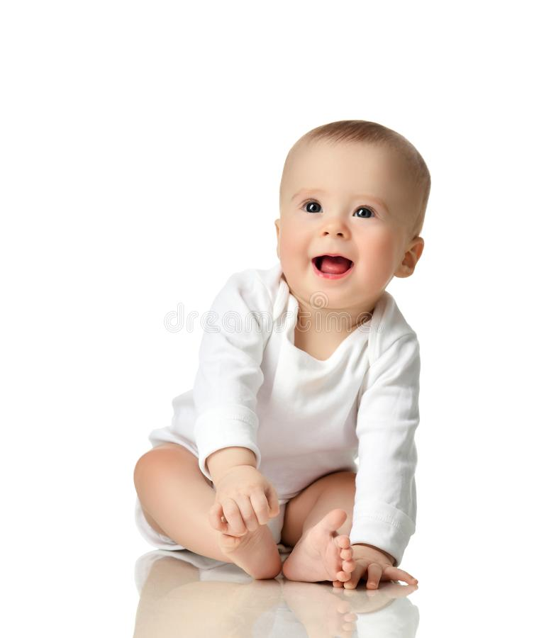 7 month infant child baby girl toddler sitting in white shirt isolated stock images