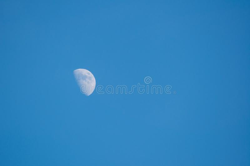 Month in the sky in the middle of the day royalty free stock images