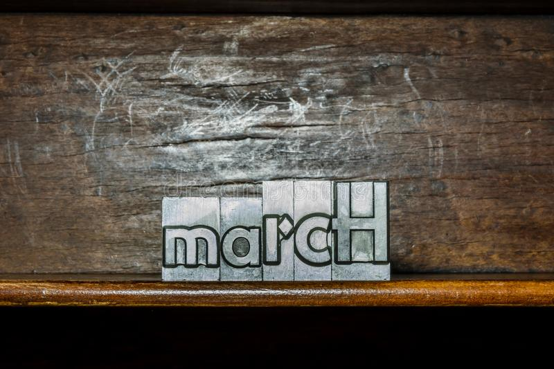 The month of the year March created with movable type printing o. N a shelf stock photos