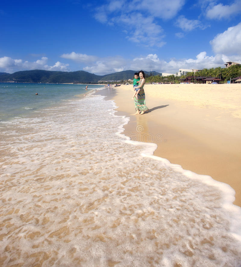 Download Monther Holding Son Walking On The Beach Stock Photo - Image: 29623900