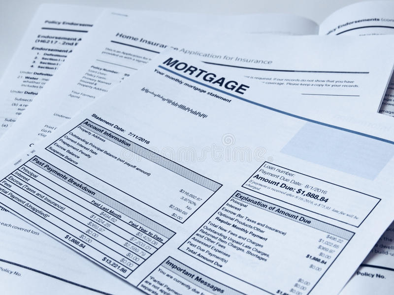 Monthly Mortgage Statement. With home insurance policy papers royalty free stock photo