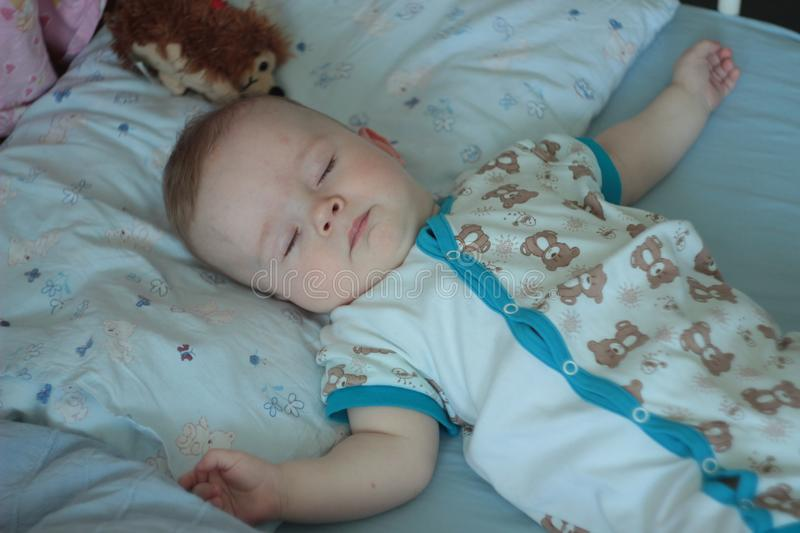 6-months-old sleeping baby stock photo