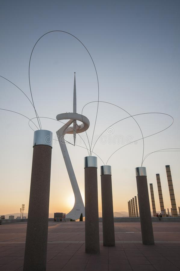 Montjuic Communications Tower by Santiago Calatrava 1991 and street lamps in the afternoon, Anella Olimpica. Barcelona. Cataloni royalty free stock images