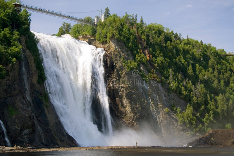 Montmorency Falls. The Montmorency Falls, or Chutes Montmorency in French, is one of the most popular tourist attraction in Quebec city. This image is from an stock photography