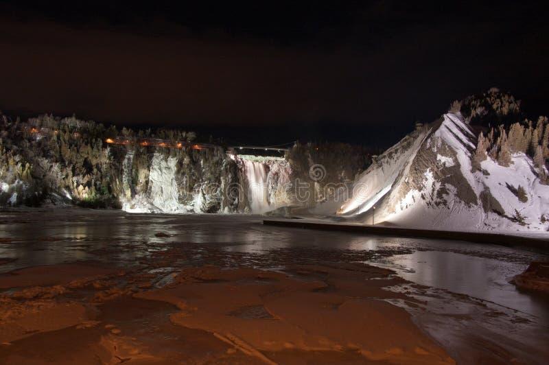 Montmorency Falls. A bridge over Montmorency Falls shot at night royalty free stock image