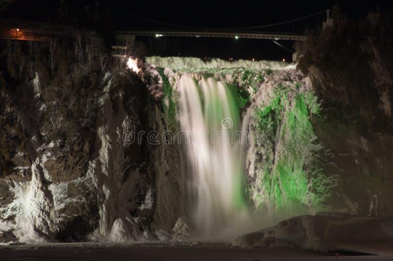 Montmorency Falls. A bridge over Montmorency Falls shot at night royalty free stock photo