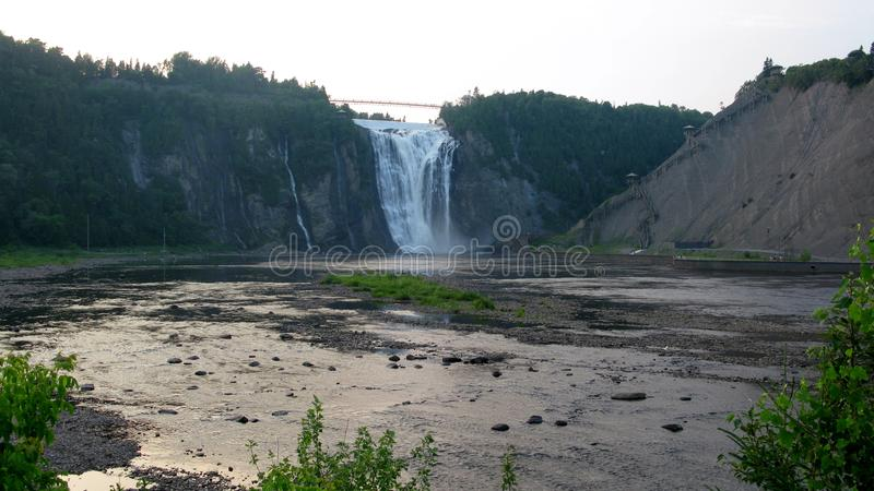Montmorency Falls (from bottom). The falls, at 84 meters (275 ft) high and 46 meters (150 ft) wide, are the highest in the province of Quebec and 30 meters (98 stock image