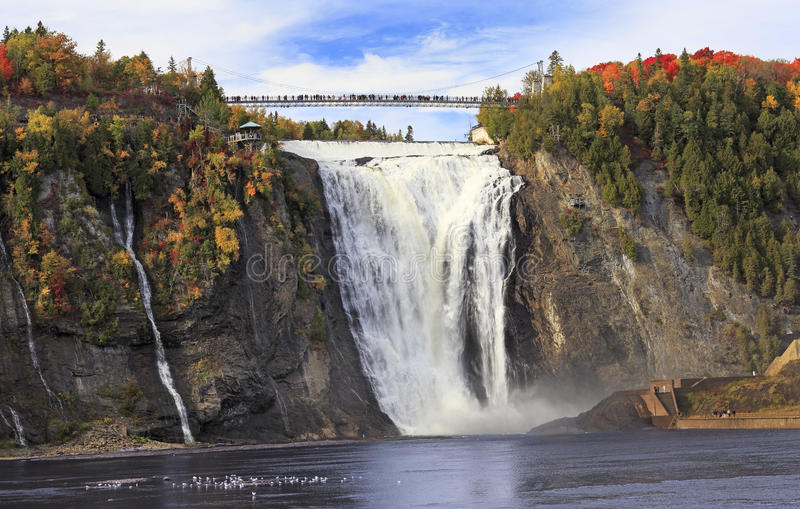 Montmorency Falls and Bridge in autumn with colorful trees, Quebec. Canada stock photo