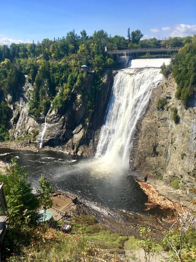 Montmorency Falls mountains, Quebec, Canada. The Montmorency Falls is a large waterfall on the Montmorency River in Quebec, Canada royalty free stock image