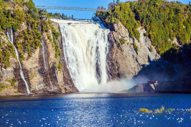 Montmorency Falls Park. Close to the center of Old Quebec. Powerful waterfall Montmorency. Sunny autumn day. The concept of active and cultural tourism stock photos
