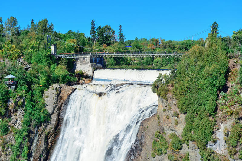 Montmorency Falls. With rainbow and blue sky near Quebec City stock images