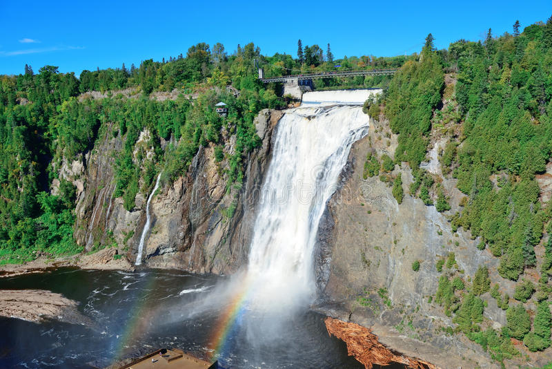 Montmorency Falls. With rainbow and blue sky near Quebec City royalty free stock photography