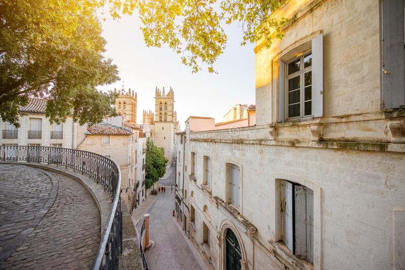 Montpellier city in France. Street view with saint Pierre cathedral at the old town of Montpellier city in Occitanie region of France royalty free stock photography