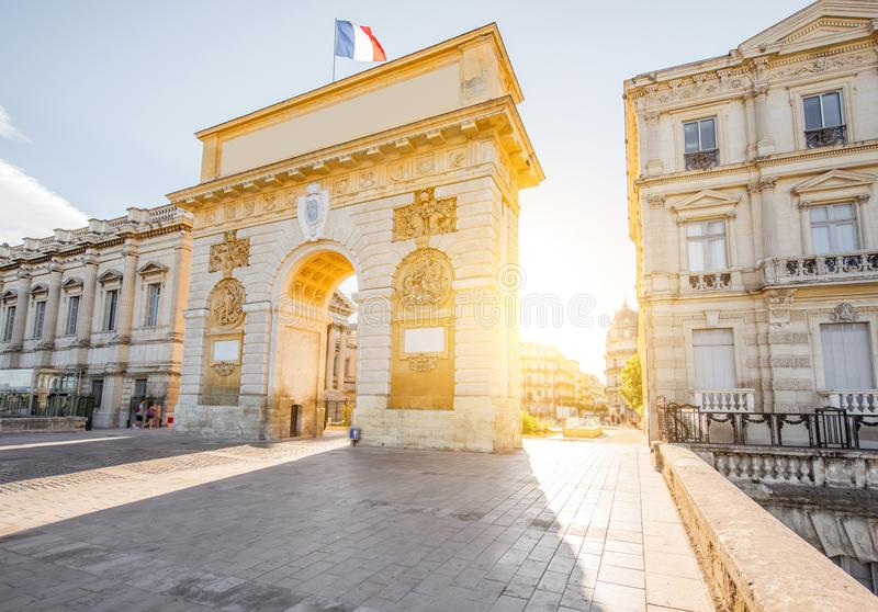 Montpellier city in France. Street view with Triumphal Arch during the sunrise in Montpellier city in Occitanie region of France royalty free stock images