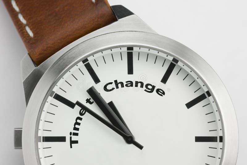 Montre avec du temps des textes de changer photos stock