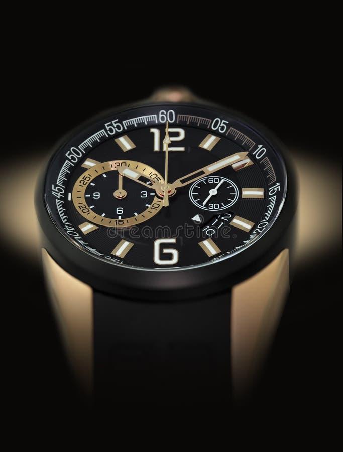 Montre-bracelet noire élégante photographie stock libre de droits