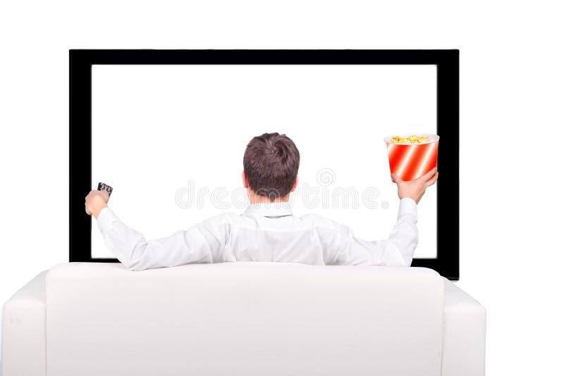 Montre d'adolescent la TV photo libre de droits